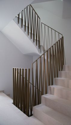 Stair with metal zig-zag railing