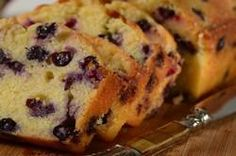 Lemon Blueberry Bread is bursting with sweet and juicy blueberries and brushing the top of the hot bread with a lemon glaze makes it moist and flavorful  From Joyofbaking.com With Demo Video