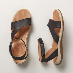 """AKIMBO SANDALS--Off-center straps add elegance to these lightweight sandals built for comfort. Padded, perforated insoles. Leather-lined straps. Adjustable ankle straps. Leather. Imported. Whole sizes 6 to 11. 1"""" Heel."""