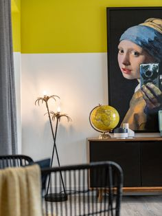 Styling detail, yellow painted band detail, yellow feature wall, girl with pearl earring artwork, statement artwork