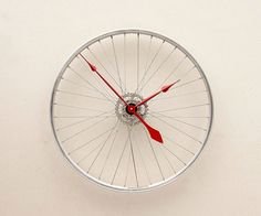 Clock made from a repurposed bicycle wheel