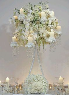 Tall elegant flowers and candles centerpiece