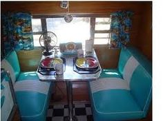Old timey Diner Booth seats and checkered floor!