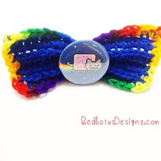 """This kawaii crochet hair bow features Nyan Cat!  Bow is made out of acrylic yarn and has a 2.25"""" button. Comes with a secure hair clip."""