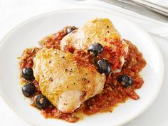 Chicken with Cacciatore Sauce : Chicken thighs are topped with stewed tomatoes, fresh veggies and salty kalamata olives in this rustic Italian dish.