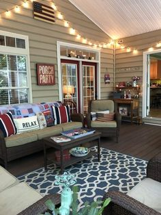 Summer screened porch tour featuring Acacia wood dining table, red bistro chairs, patriotic pillows and decor, nautical porch decor, red, white and blue Screened Porch Designs, Screened In Porch, Screened Porch Decorating, Back Porch Designs, Porch Swing, Home Porch, House With Porch, Outdoor Lounge, Outdoor Rooms