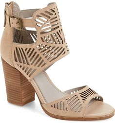 Angled laser cutouts perforate the statement straps and cuff of a block-heel sandal made in lush nubuck leather.