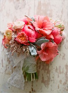 Like the flower combination, like the idea of bridesmaid/brides bouquets being wrapped in lace