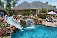 Bossier City Pool Design, Shreveport Pool Construction - natural-grotto-slide-aqua-blue-pebble-sheendolphin-slide