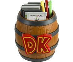 PDP Donkey Kong Barrel Game Card Storage - Nintendo Officially licensed by Nintendo Holds up to 8 Nintendo or Nintendo DS Game Cards Includes storage for styluses Made from durable hard plastic Familiar Donkey Kong Barrel design Nintendo 2ds, Super Nintendo, Nintendo Games, Nintendo Decor, Nintendo Room, Nintendo Characters, Nintendo Switch, Video Game Storage, Dorm Ideas