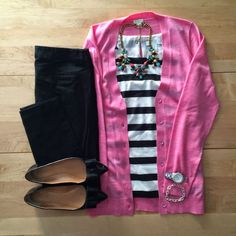black pants, bright sweater, striped top with statement necklace