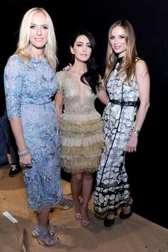 Designers  Keren Craig (L), Georgina Chapman (R) and guest attend the The Marchesa Spring/Summer 2017 Fashion Show Co-Hosted by FIJI Water during New York Fashion Week at The Dock, Skylight at Moynihan Station on September 14, 2016 in New York City.