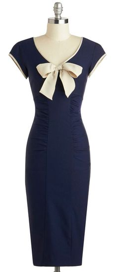 Navy Dress With A White Bow