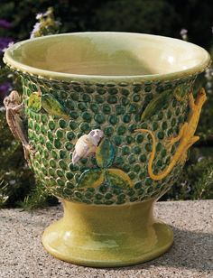 Handmade and hand-painted in Italy using traditional glazing and firing techniques, this decorative flowerpot brightens any space indoors or outside.