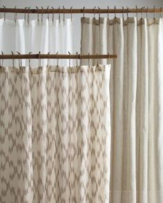 Eileen Fisher Sheer Linen Shower Curtain ($128) - really sheer, and buttonholes not metal holes