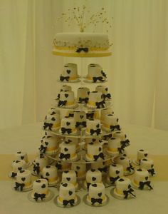 Round mini Wedding Cakes Black and Gold Hearts, black bow tie to each cake. Top cake for cutting from Norfolk, Suffolk, East Anglia, Wedding Cake Maker, Anne's Cakes For All Occasions