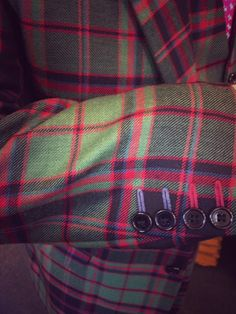 When we make you a tartan suit you can choose as much bespoke detailing as you like such as colourful button shams. Kilts4all, Kings Cross, London