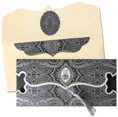 Black is beautiful !! This amazing Black invite with mesmerizing silver intrinsic designs, beautiful silver tassel and an auspicious Bismillah logo is an spellbinder for sure !! Shop exclusive Muslim wedding cards at www.regalcards.com