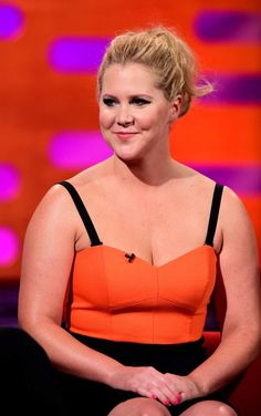Amy Schumer Poses Nude with a Dog Dressed in Hot Dog Costume—Yes, Really Famous Celebrities, Celebs, Hotdog Costume, Curvy Women Outfits, Amy Schumer, The Daily Show, Dog Dresses, Orange Dress, Bellisima