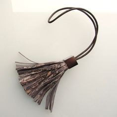 Leather tassel bag charm in brown and beige snake print embossed leather handmade by RinartsAtelier