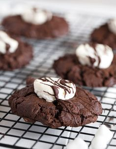 Rich, chocolate cookies, topped with a marshmallow and finished with a drizzle of chocolate. Enjoy warm for a hot cocoa experience anytime. Marshmallow Cookies, Cocoa Cookies, Double Chocolate Cookies, Pastry Recipes, Baking Recipes, Cheesecake Recipes, Dessert Recipes, Desserts, Chocolate Marshmallows