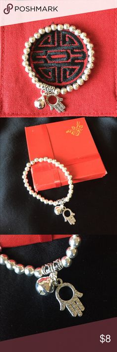 Good Luck Bracelet Silver colored ball bearings bracelet with charming Hamsa Hand for good luck. The holder of the Hamsa expects to be protected from negative energies. The most common negative energy being envious glares from people wishing you no good. So get your Hamsa to ensure your positive energy!!! Jewelry Bracelets