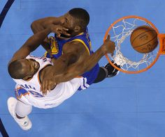 Oklahoma City's Serge Ibaka (9) dunks over Golden State's Festus Ezeli (31) during Game 3 of the Western Conference finals in the NBA playoffs between the Oklahoma City Thunder and the Golden State Warriors at Chesapeake Energy Arena in Oklahoma City, Sunday, May 22, 2016. Photo by Bryan Terry, The Oklahoman