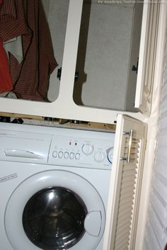 An RV washer dryer combo unit with the closet above. photo by Lynnette at TheFunTimesGuide.com