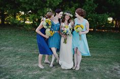 Not blue, but greens or yellow. Basic idea of mismatching the dresses.