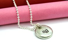 Beautiful aluminum drop is hand stamped with your initial. I just love this thick aluminum initial tag. This makes a great gift for the girls. Aluminum