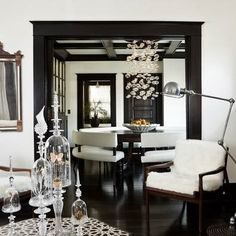 white paint and black trim for hallway. I like this look for a formal dinning room.