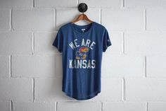 Tailgate We Are Kansas T-Shirt by  American Eagle Outfitters | The mythical Jayhawk, a combination of a blue jay and sparrow hawk, goes back to unknown times in territorial Kansas. Shop the Tailgate We Are Kansas T-Shirt and check out more at AE.com.