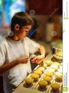 Boy Putting Icing On Cupcakes. - Download From Over 45 Million High Quality Stock Photos, Images, Vectors. Sign up for FREE today. Image: 61820323