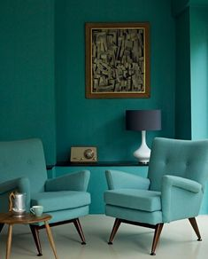 Bright turquoise leggy chairs and textured walls in a Populuxe setting (Atomic…
