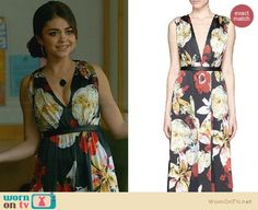 Haley's black floral maxi dress at the wedding on Modern Family.  Outfit Details: http://wornontv.net/32874/ #ModernFamily