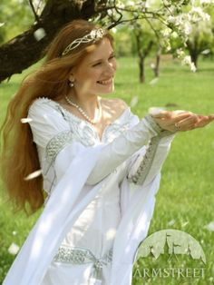 Design of this  medieval wedding dress is fully original. Dress is made of great quality German thin natural cotton and chiffon.  Embroidery is made in Celtic style with silver rope.  Embroidery decorated with Czech glass and beads.  Lacing at sites and back allows to adjust size for your figure very preciously.