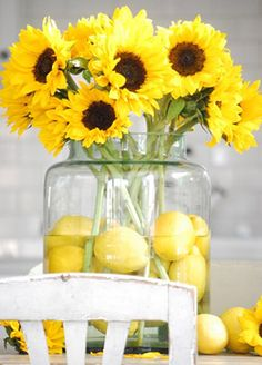 Lemons & Sunflowers are signs of summer! This fruit and flower arrangement is both easy to arrange and affordable! Lemons are available year-round from your local grocery store and sunflowers are available year-round from GrowersBox.com.
