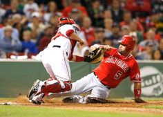 BOSTON, MA - AUGUST 18: Albert Pujols #5 of the Los Angeles Angels is tagged out at the plate by Christian Vazquez #55 of the Boston Red Sox in the eighth inning at Fenway Park on August 18, 2014 in Boston, Massachusetts. (Photo by Jim Rogash/Getty Images)