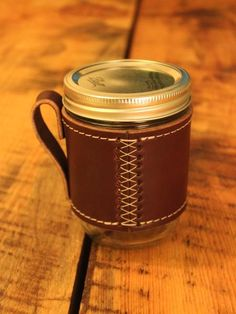The Holdster Model 01: Cross Stitch. Made from genuine top-grain vegetable-tanned leather. Designed for a snug fit on a standard 16oz. wide-mouth mason jar.