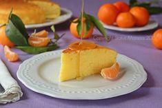 Torta con il succo dei mandarini e panna da montare senza burro con olio, perfetta per la colazione e la merenda.