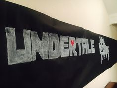 UNDERTALE Birthday Banner.... Hubby and I made this for our 9 yr old.  Used a roll of black paper, outlined with chalk and used white chalk paint to fill in with  square sponges. Hope it helps ! I kept just in case someone needs it in Houston 77084.