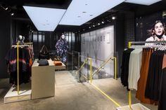 A single run cast concrete staircase descends into the 183 square-metre basement and lands to face the back focal point of the store. This positioning subtly encourages a journey around the space, allowing you to fully explore key collections before arriving at the fitting rooms.