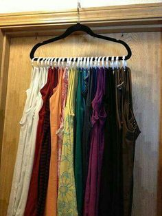 Tank top organizer!  Shower rings from Dollar Tree, look tank straps through, attach to a single hanger. Can hold approximately 30 tanks!