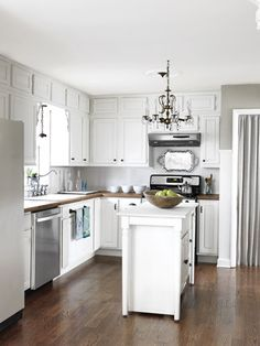 like the extra tiny cabinet above the cabinets, open space by kitchen window and these cabinets were wood colored...painted white!!