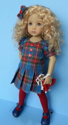 Lovely bright blue tartan plaid dress with pleats and winter tights. Made by Salstuff in the uk, ships to most countries.