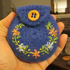My first small felted wool coin purse. The purse was crocheted: two flat rounds, and a flap embroidered onto one. The two were crocheted together. After being felted in the washing machine, the d...