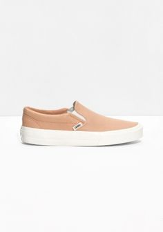 VANS Crafted from leather, these classic slip-on shoes are made for those run-around-days.