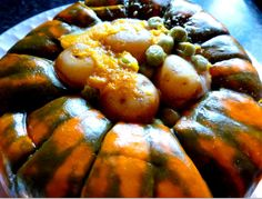Speckled Hound Squash with creamed new potatoes and fresh garden peas makes a lovely fall arrangement for your holiday dining