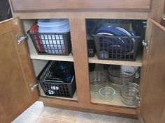 Organized Storage Containers in Organized Island Cabinets.