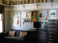 Who said your home office has to be drab? Make it your own! Add your personal touch with fun artwork and accents. See how at Outlaw Design Blog